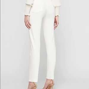 Slim fit white jeans, never worn, just washed.